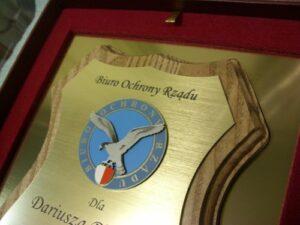 Dyplom grawerowany w laminacie metalizowanym z nakładką z laminatu