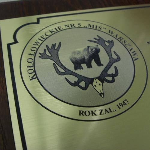 Logotyp umieszczony na dyplomie wykonany z laminatu metalizowanego