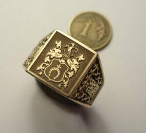 Herb  - grawerunek laserowy w złocie