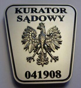 Odznaka - pokrycie satyna niklowa orzeł jako nakładka, grawerunek czarny