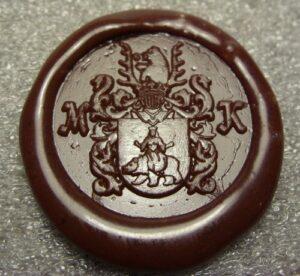 Odcisk herbu wygrawerowanego w stemplu mosiężnym