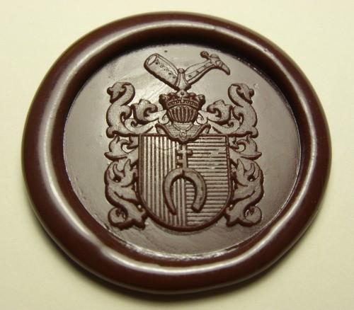 Odcisk lakowy herbu PRUS wygrawerowanego w stemplu mosiężnym