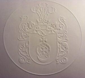 Herbowa pieczęć sucha - odcisk na papierze