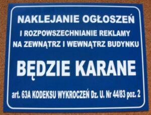 Tablica ostrzegawcza grawerowana w niebieskim laminacie
