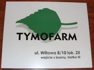 Szyld grawerowany w laminacie białym -  logo wykonane z dwóch kolorów laminatu jako nakładka