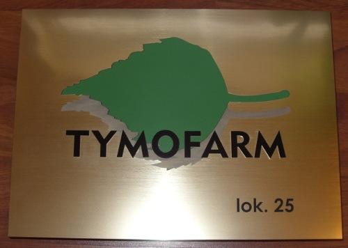 Szyld grawerowany w laminacie złotym -  logo wykonane z dwóch kolorów laminatu jako nakładka