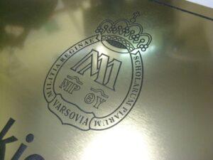 Szyld grawerowany w laminacie metalizowanym złotym