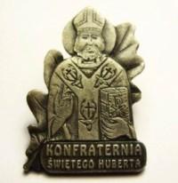 Znaczek mosiężny srebrzony z wizerunkiem św. Huberta
